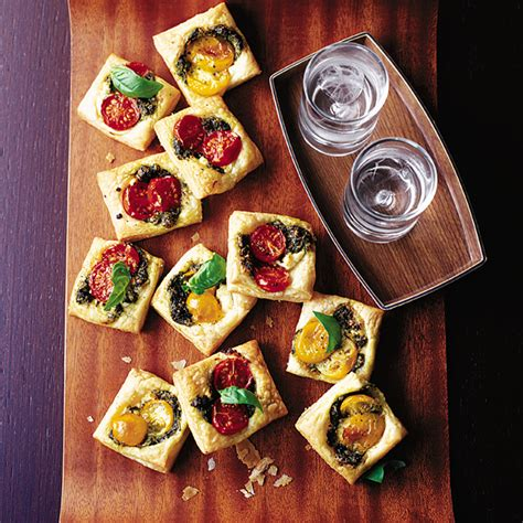 puff pastry canapes ideas pastry squares with goat 39 s cheese pesto and tomato