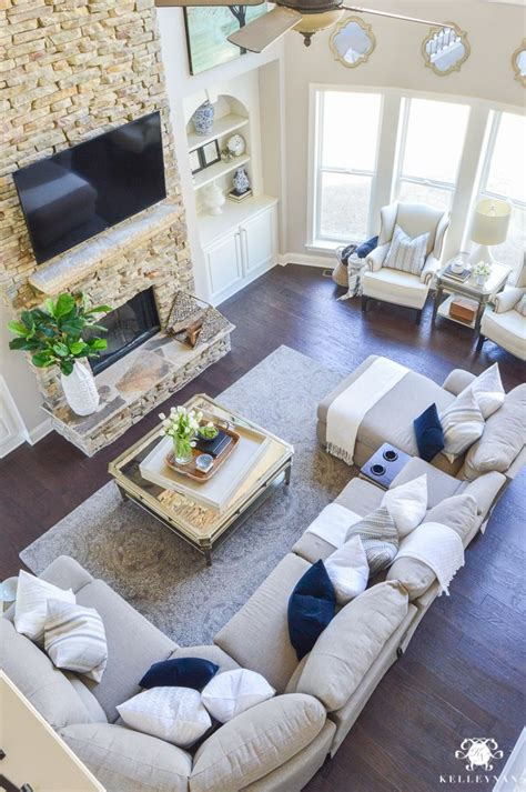 Living Room With Sectional And Corner Fireplace by Decked And Styled Home Tour Kelley Nan Two Story
