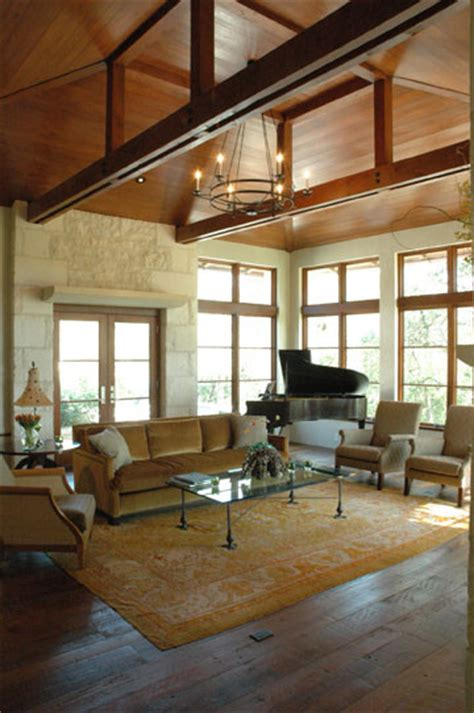 living room grand piano vaulted ceiling wood planked