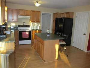 Help! What color to paint kitchen with oak cabinets and
