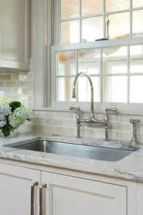 bridge kitchen faucets gray subway tile backsplash transitional kitchen
