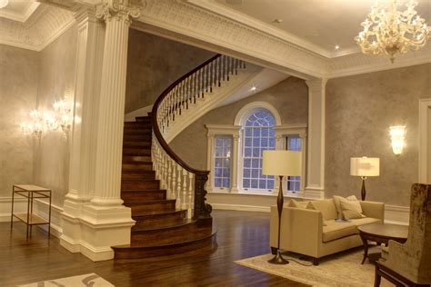 burnished venetian plaster adds polish  lobby walls  staircase arteriors