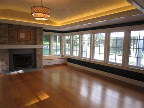 sunroom with fireplace tray ceiling led lighting