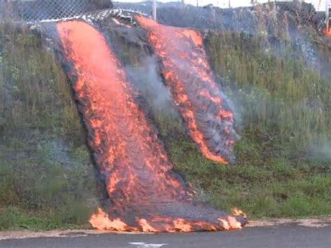 River of lava slowly burns through Hawaiian town