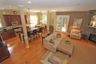 open floor plan kitchen and living room enchanting beige fabric modern sofa in open living room decors added modern dining room sets as