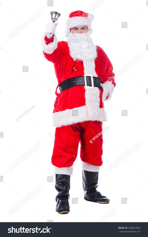 traditional santa claus ringing on merry christmas to you traditional santa claus ringing a bell and looking at camera while