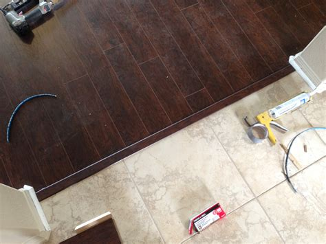 laminate wood flooring next to tile tile transition to laminate tile floor kitchen pinterest dark wood woods and google search