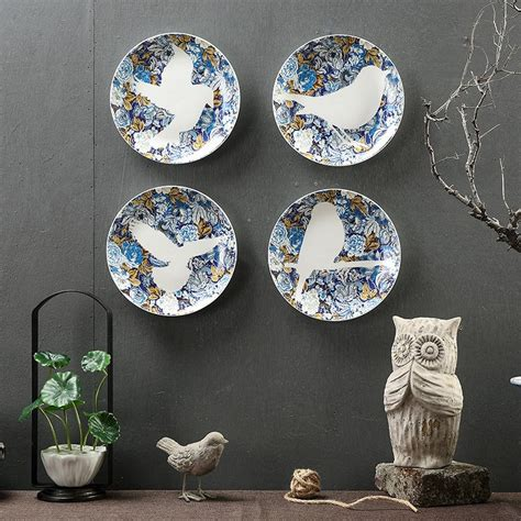 They are an easy and inexpensive way to add a decorative accent to any room by matching or complementing other design elements such as cabinet hardware, plumbing and lighting fixtures, flooring, wall. Creative Lovely Bird Ceramic Decorative Plate Living Room Office Bedroom Wall Hanging Plates-in ...