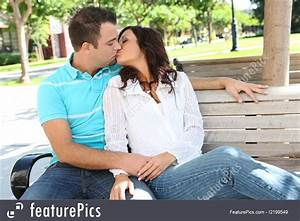 People  Couple Kissing On Bench At School