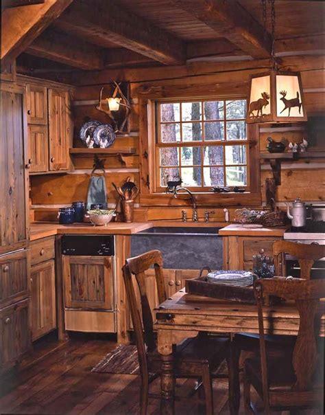 log cabin kitchen cabinets jack hanna 39 s cozy log cabin in montana log cabin