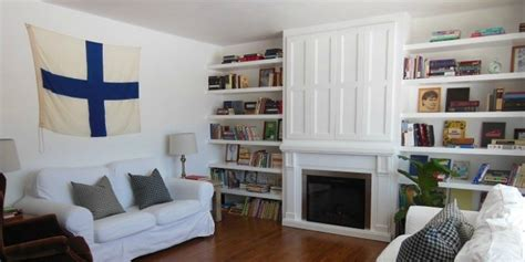 remodelaholic built  fireplace surround  shelving