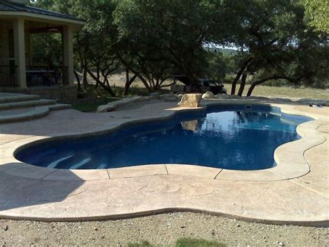 stamped concrete  border  pool