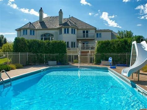 House Wow: Two Story Windows Overlook Outdoor Pool in