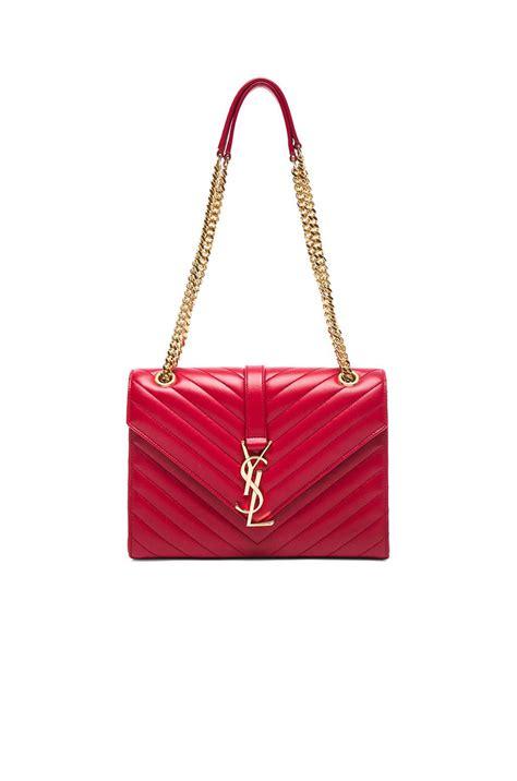 saint laurent leather medium monogram envelope chain bag  red lyst