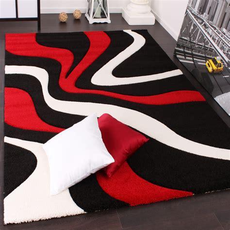 designer teppich mit konturenschnitt wellen muster rot