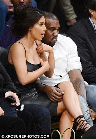 kim kardashian adjusts  tight leather dress   sits