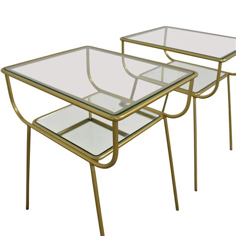 Its durable, tempered glass shelves appear to hover above its mirrored glass base. 18% OFF - West Elm West Elm Curved Terrace Nightstands / Tables