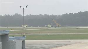 Military plane goes off runway at Newport News ...
