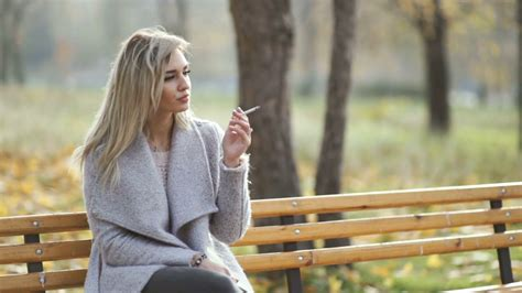 Young Beautiful Business Woman Smoking A Cigarette In The