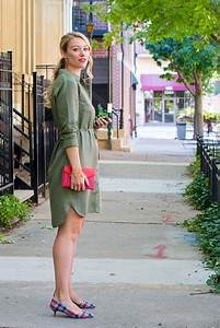 Picture Of With olive green shirtdress and red clutch