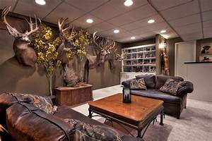 Outdoorsman rooms the rest are of the trophy room in the for Hunting decor for living room