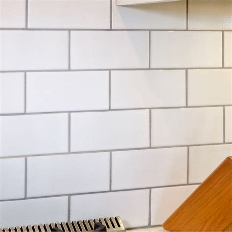 crackled white 3 x 6 x 3125 subway tile with delorean gray grout tile grey