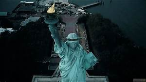 Above New York Statue Of Liberty And Liberty Island