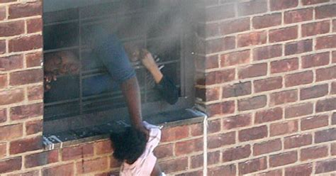 dramatic photo  baby hanging  window  burning