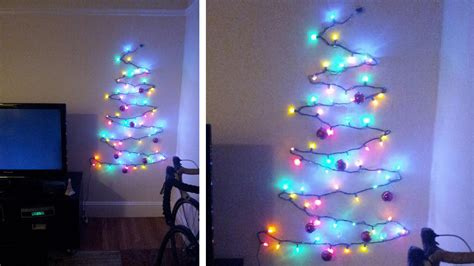 light tree on wall this clever christmas tree is the answer to your cred
