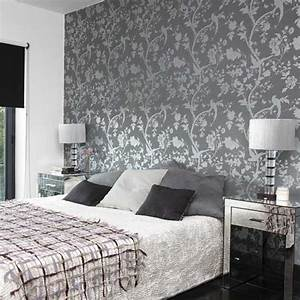 Bedroom with patterned wallpaper