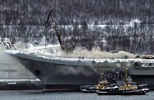 Russia's Kuznetsov carrier catches fire | Jane's 360