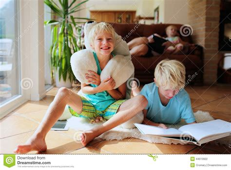 A Bright Home To Give A Family A Taste Of The by Family Quality Time At Home Stock Photo Image Of