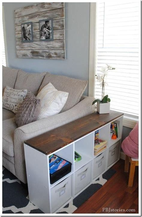 This table is available in a natural finish that lets the imperfections of wood shine through. 16 Out-of-the-Box Ways to Use Storage Cubes   Family friendly living room, Living room storage ...