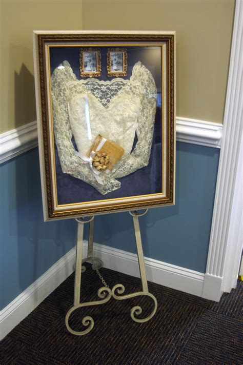 we framed my grandmothers wedding dress along with the