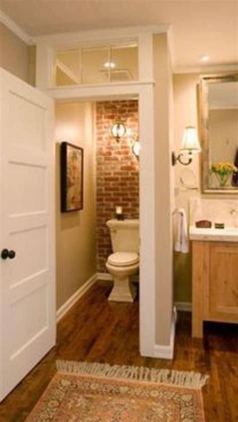 exposed brick privacy bathroom  house   bathroom toilet closet home