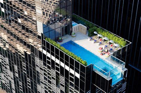 glass pool cantilevers  hong kongs hotel indigo  aedas