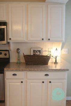 do you tile kitchen cabinets white cabinets with bronze knobs and cup pulls i think i 9606