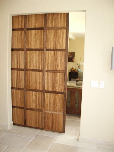 Walnut and Zebra Wood Hanging Door  Contemporary Entry