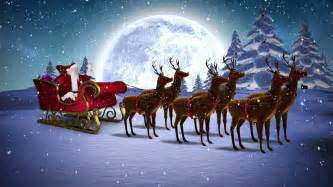 digital animation of santa waving in his sleigh with reindeer and greeting hd stock footage clip