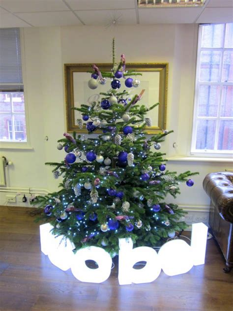 corporate christmas tree blue and silver flowers by