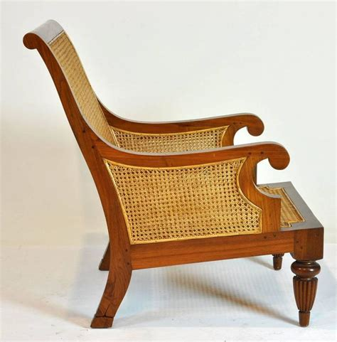 colonial imports caned leather plantation style