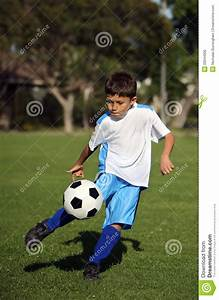 Boy Playing Soccer Royalty Free Stock Image - Image: 20044906