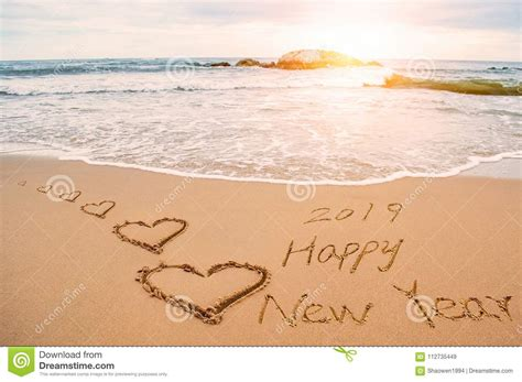 Write Happy New Year 2019 On Beach Stock Image