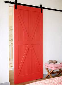 florida beach cottage with beautiful coastal interiors With barn door red paint