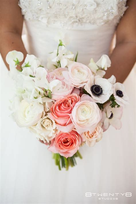 bridal bouquet featuring ranunculus anemone sweetpea