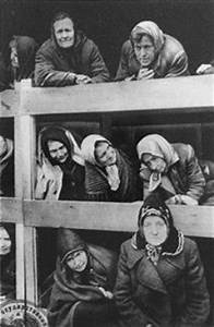 Former women prisoners on the wooden bunks that served as ...