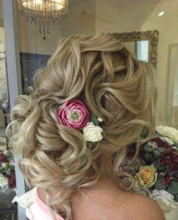 Loose Curl Low Updo Flower Accessory Wedding Hairstyle