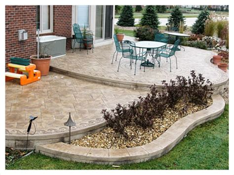 concrete patio landscaping ideas here s a brown tinted two tiered sted concrete patio with a built in flower bed yard