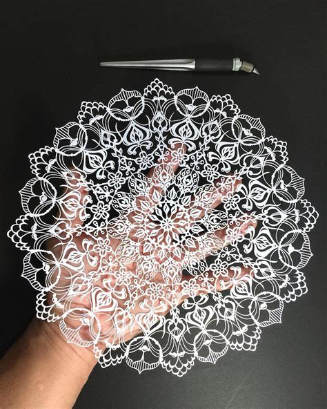 mandala paper cutting template hand cut mandalas and other intricate paper works by mr