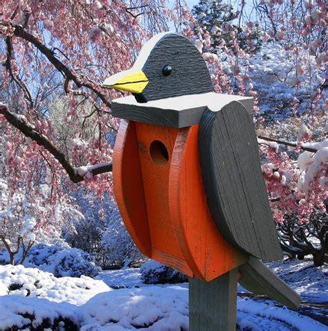 amish hand  bird shaped birdhouse robin